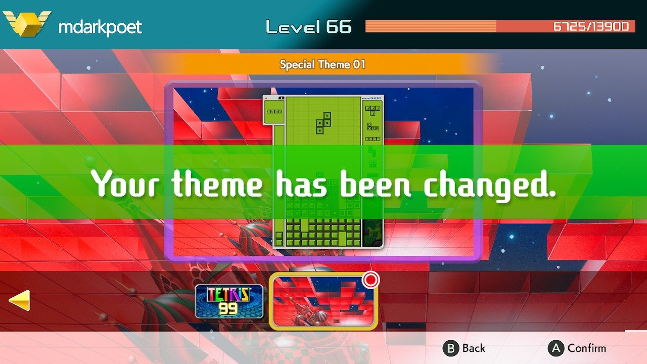 Tap the A button to confirm your theme selection in Tetris 99.