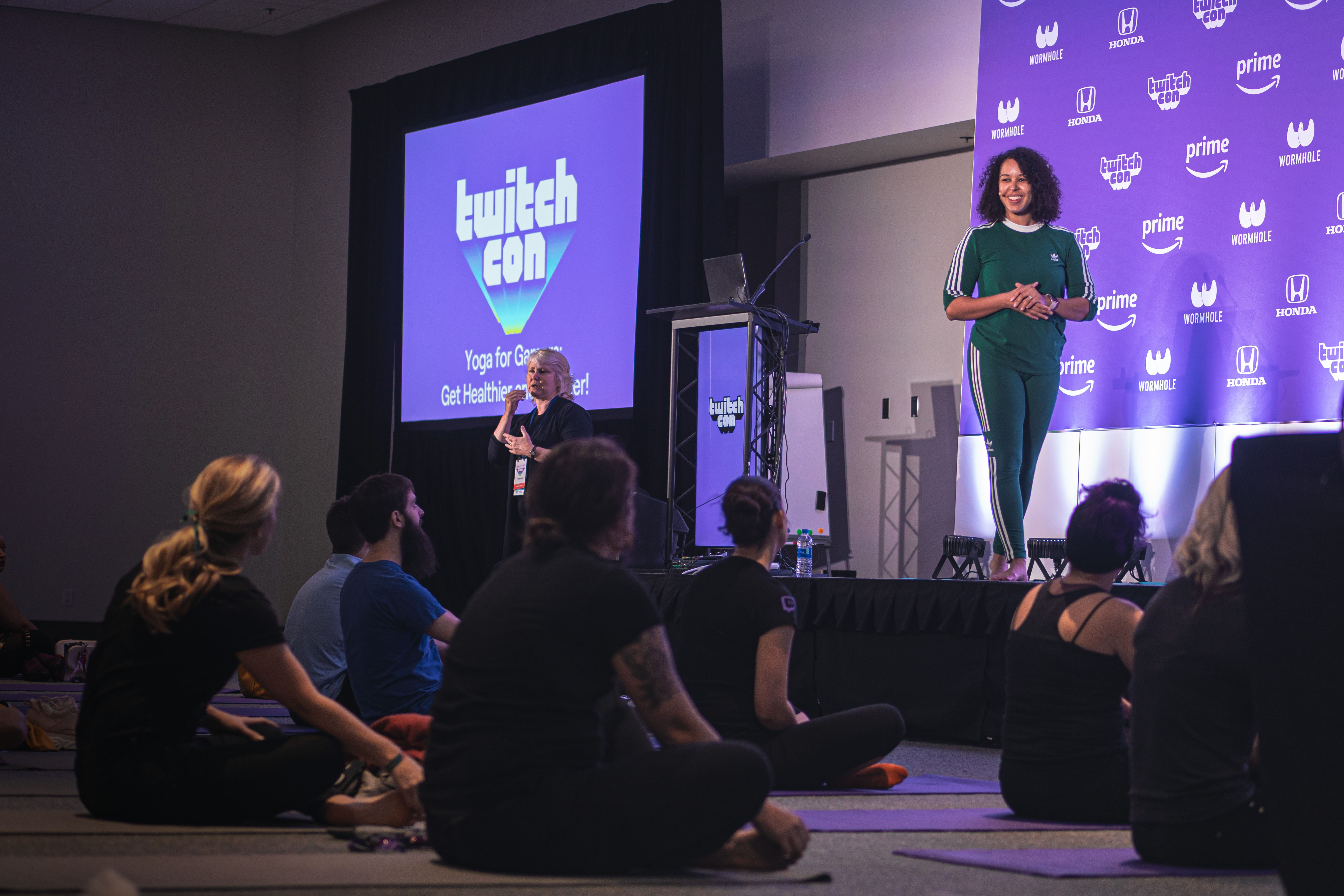 Amber leading the Yoga For Gamers panel at TwitchCon