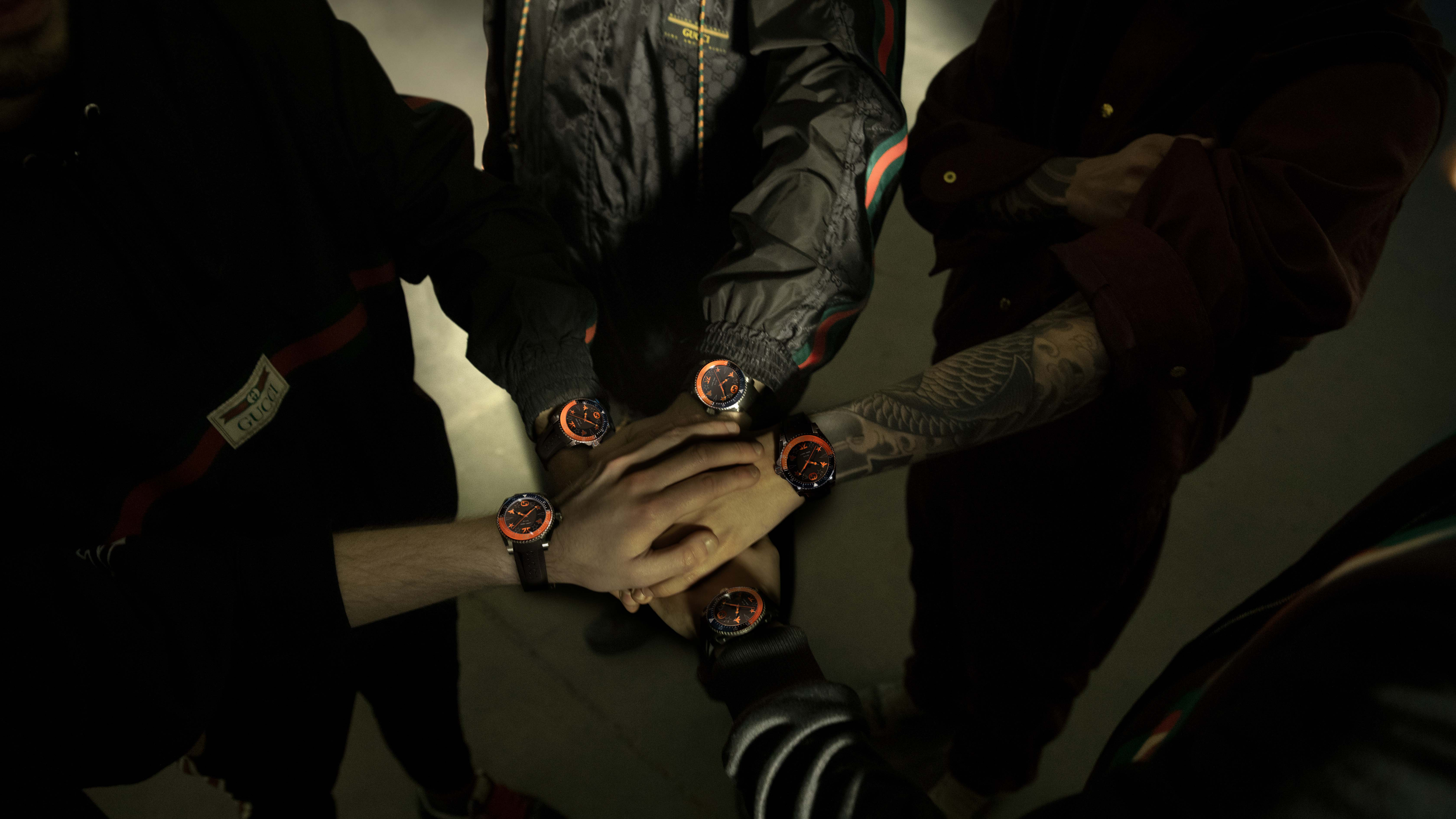 The Gucci X Fnatic Dive Watch collab as modeled by the org's League of Legends team. © Gucci/Fnatic